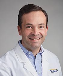 Dr. Darius Schneider